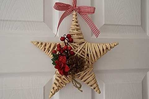 Wicker Star natural with poinsettia, red berries and cone -
