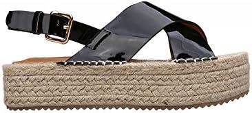 Sandalia con tiras anchas cruzadas. Cuña revestida de yute en color natural. Altura plataforma 4,0 cm.
