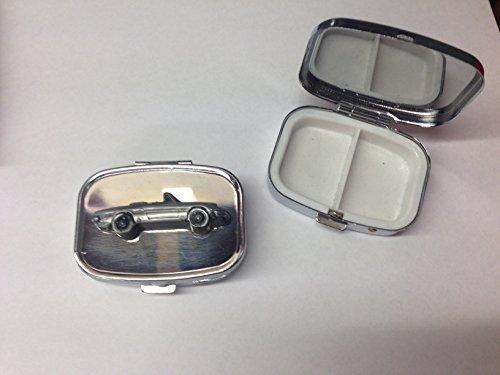 alfa-romeo-kham-tail-spider-ref3-pewter-effect-car-emblem-on-travel-silver-rectangular-metal-pill-bo