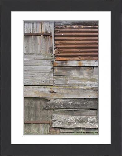 framed-print-of-old-weather-beaten-rusty-corrugated-iron-siding-amidst-wooden-slats-on-a-hut