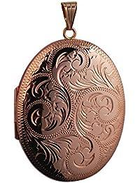 Con medallón 45 x 35 mm, oval en oro, 375/1000 y tallado a mano