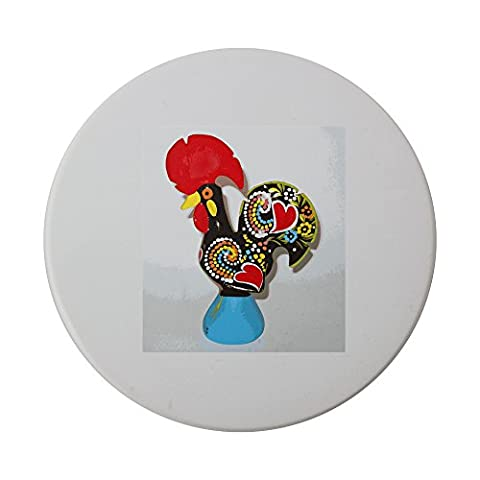 Ceramic round coaster with A multi color craft in a cock shape