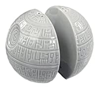 That's no moon! Coming to a cantina table near you, the infamous Death Star is set to help you season breakfast, lunch, and dinner the Empire way! Made of the highest quality ceramic, these condiment shakers are molded and painted to look jus...