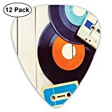 Guitar Picks 12-Pack,Gramophone Records And Old Audio Cassettes On Wooden Table Nostalgia Music