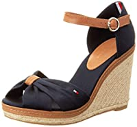 Tommy Hilfiger Elena 56D is ideal for any occasion. Featuring a midnight canvas and leather upper, Tommy Hilfiger flag logo on the side, 10cm wedge sole and adjustable leather ankle strap with gold-toned buckle. Also available in Dusty Rose. ...