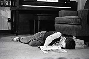Young boy sleeping on floor Poster (45,72 x 60,96 cm)