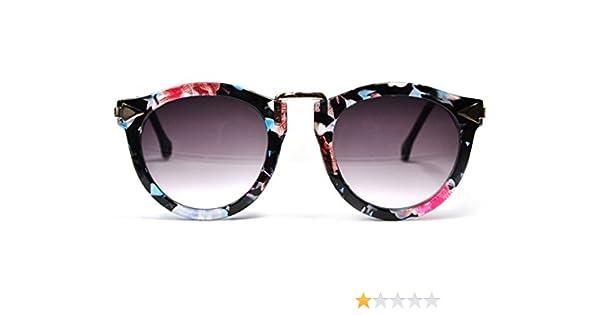 CoolChange lunettes de soleil vintage classiques avec des tiges d or et un  motif de fleurs  Amazon.fr  Jeux et Jouets 9a8dd6753b33