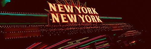 New York New York Hotel Casino (Panoramic Images - Panoramic View of New York New York Hotel and Casino and neon Lights Las Vegas NV Photo Print (68,58 x 22,86 cm))