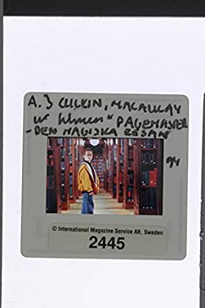 "Slides photo of Macaulay Carson Culkin in the scene from a 1994 American live-action/animated fantasy adventure film ""The Pagemaster""."
