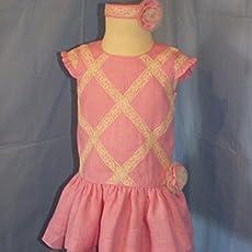 Vestido de celebración de lino rosa y pasada para el pelo