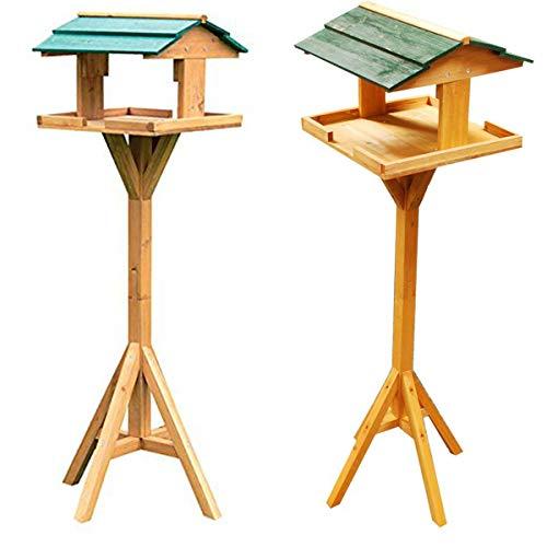 Tradicional madera pájaros alimentador. Casa techo
