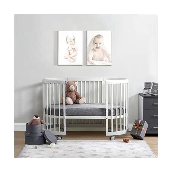 DUWEN Wooden Baby Cot European Multifunctional Small Round Bed Child Bed Convertible To 3 Positions Toddler Bed Sofa Bed Suitable For Cribs Under 6 Years(With Mattress) DUWEN 【CONVERTIBLE CRIB】:Easy-to-change 3-in-1 cot can be easily converted from a crib to a nursing table and crib. The versatile crib will provide your child with a comfortable sleep. Beautifully designed cribs can grow with your child from infancy through childhood to adulthood. 【GROW UP WITH YOUR BABY】: The 3-bed mattress height adjustment function on the crib allows you to lower the mattress when your baby starts sitting or standing. It can keep your baby safe and comfortable in the bed that grows up with your baby. This convertible adjustable multifunctional bed will make your child's life unforgettable. 【STURDY PINE WOOD】: The crib is made of high-quality beech wood, which is sturdy and durable, bears more weight, has a carrying capacity of more than 150KG, is easy to assemble, and is designed for the healthy sleep of babies aged 0-6. 3D mousse growth mattress provides babies with comfortable and undisturbed sleep. 6