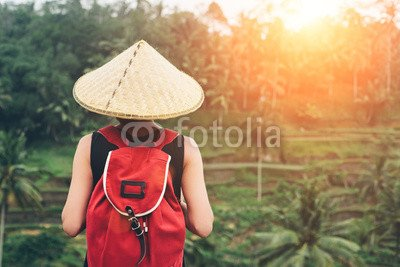 druck-shop24 Wunschmotiv: Young lady with traditional Asian hat and backpack standing and looking at tea plants (intentional sun glare) #105995460 - Bild als Klebe-Folie - 3:2-60 x 40 cm/40 x 60 cm