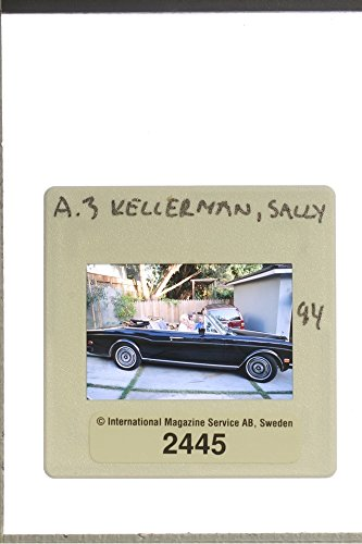 slides-photo-of-sally-kellerman-with-her-family-in-a-vehicle