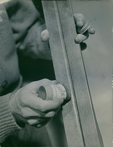 vintage-photo-of-waxing-of-a-ski-using-swix