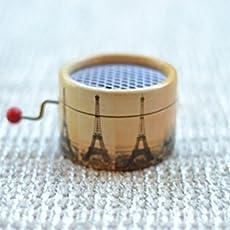 Caja de música manual redonda con la melodía del * La Valse dAmelie * decorada.