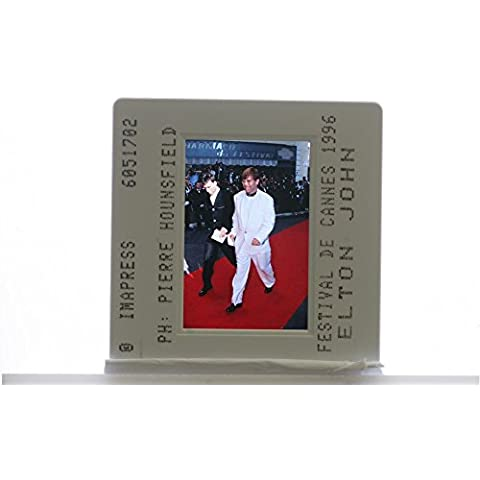 Slides photo of English pianist and singer Elton John walking