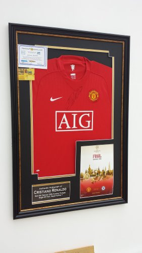 Cristiano Ronaldo of Manchester United Signed shirt OFFICIAL CHAMPIONS LEAGUE PROGRAMME DISPLAY