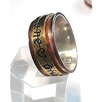 Anello girevole - anello filatore - con codice segreto e testo personalizzato. Anello d'argento, rame e ottone.