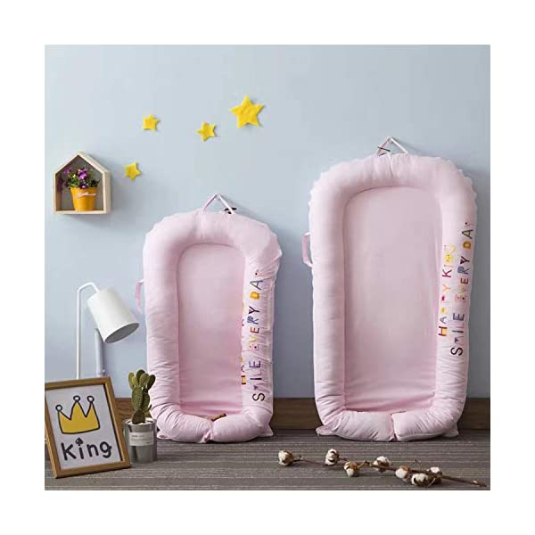 YANGGUANGBAOBEI Baby Lounger Cushion,for Newborn - Babies - Soft Sleeping Cribs Cuddle Pads,100% Cotton Portable Crib,Pink(small) YANGGUANGBAOBEI [Portable]: The lightweight design makes the baby lounger easy as a bassinet for a bed, or travel bed. Makes baby feel more secure and cozy. [Breathable Material]: Made of 100% cotton fabric and high quality 3D polymer material filler. Safe to baby's sensitive skin. It can give your baby safe and just like sleeping in the mother's arms, enjoying more deep sleep. [Creative Design]: The baby lounger simulates the bionic design of the uterus, like sleeping in the mother's arms, enjoying more deep sleep, and reducing the frequency of putting kids go to bed. 7