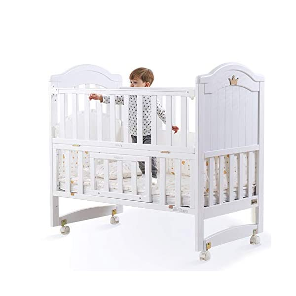 VBARV Multifunctional cradle bed-three-in-one stitching large bed solid wood crib, pine oversized children's play bed, bedroom furniture suitable for children aged 0-12 VBARV Non-toxic environmental protection material, no sharp fixing device, external dimensions are 125x72x104cm. Side-open fence, drowsy, easy to care for babies and able to hug in and out; can be spliced   into a large bed for easy feeding. The bed has four positions and is adjustable in height. The bed can be turned into a playground, cradle bed, sofa, desk, and is a multifunctional bed. Easy to clean and maintain: The surface of the crib can be wiped with a damp cloth to remove dust or dirt from the surface. 1