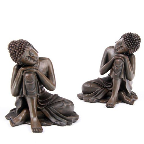 Coppia di statuette effetto legno a forma