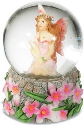 Boule de neige fée et fleurs roses