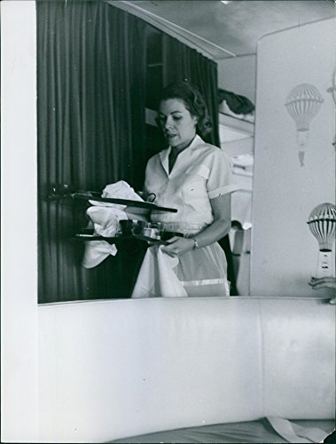 vintage-photo-of-1959a-photo-of-a-flight-attendant-in-the-airplane-carrying-the-plates-and-food-item