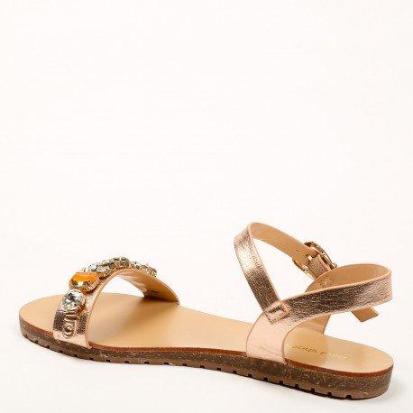 Ideal Shoes - Sandales plates effet pailleté avec lanière décorée de strass Vaea Champagne