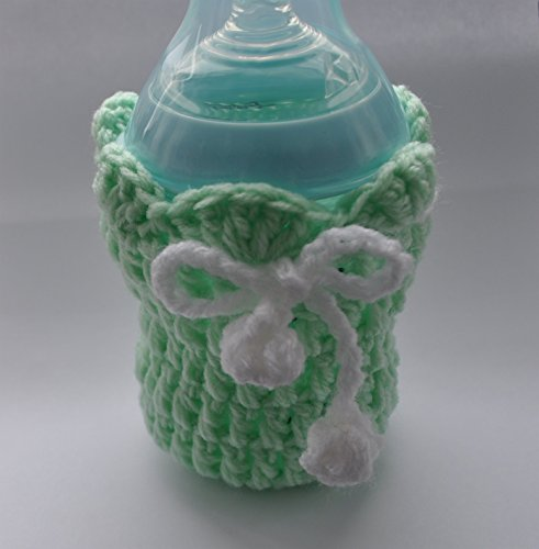 Handmade crochet baby feeding Bottle Cover with a Shell Pattern finish and a pom pom drawstring 41FA9T3Sw L