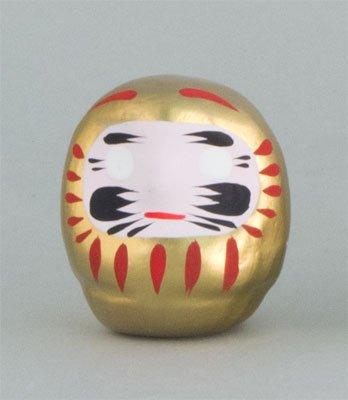 Daruma, amuleto de la suerte japonesa de Kyoto, oro para el dinero y l