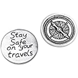 Compass travel token with 'Stay safe on your travels' message on reverse