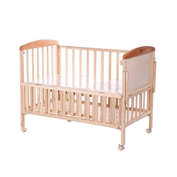 QINYUN Crib Solid Wood Without Paint Multi-functional Baby Bed Game Bed QINYUN 1. This portable crib is made of sturdy pine wood with a beautiful, non-toxic appearance, with a hard hat and locking wheel that can be converted from a crib to a baby fence with one hand. 2. Soft and encrypted mosquito net, strong and not decoupled, providing a comfortable sleeping environment for your baby The mattress attached to the cradle is gently shaken to sleep every night. 1