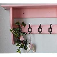 Pink wall shelf with hooks