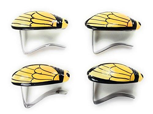 Lot de 4 pinces accroche nappe en forme de cigale jaune décoration ailes stylisées liseret noire