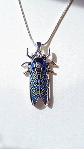 bug-beetle-pendant-hand-enamelled-in-blue-green-and-black-with-a-swarovsky-crystal-fitted-in-the-mid