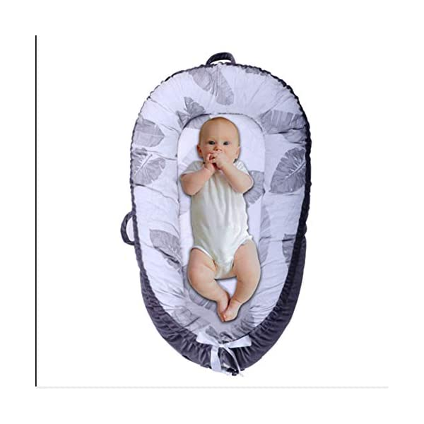 Mr.LQ Crib Bed Removable And Washable Portable Washable Uterine Bionic Bed,color2,80x50cm  ☀100% cotton fabric and breathable, hypoallergenic internal filler, which is safe for baby's sensitive skin. It will give your child serene, safe, and sound sleep in their lovely co sleeper bassinet. ☀Being adjustable, the side sleeper grows with your baby. Simply loosen the cord at the end of the bumpers to make the size larger. The ends of the bumpers can be fully opened. ☀Use the infant nest as a bassinet for a bed, baby lounger pillow, travel bed, newborn pillow, changing station or move it around the house for lounging or tummy time, making baby feel more secure and cozy. The lightweight design and easy-to-use package with handle make our newborn nest a portable baby must-have. 6
