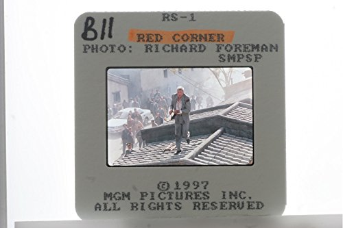slides-photo-of-richard-gere-running-at-rooftop-a-scene-in-the-film-red-corner-an-mgm-pictures-inc