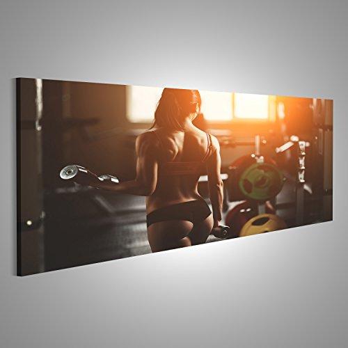 ndbild Leinwandbild Bilder Poster Athletische Frau pumpt Muskeln mit Hanteln. Brunette sexy Fitness Mädchen Panorama Format ! Direkt vom Hersteller ! (Frau Bild)