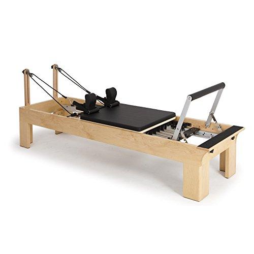 Elina pilates. reformer in legno - macchina pilates per professionisti. reformer sviluppato da esperti tecnici di pilates di tutto il mondo. altezza del letto di 27 cm.