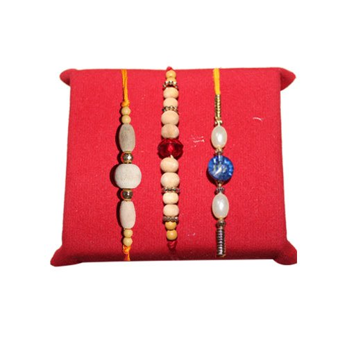 handicrunch-rakhi-set-with-haldirams-rasgulla-white-pearl-designed-rakhi-of-3-set