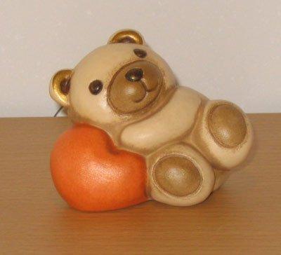 Thun teddy berto sdraiato su cuore