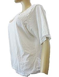 La siguiente de color blanco con diseño de lentejuelas y de manga corta para de detalle