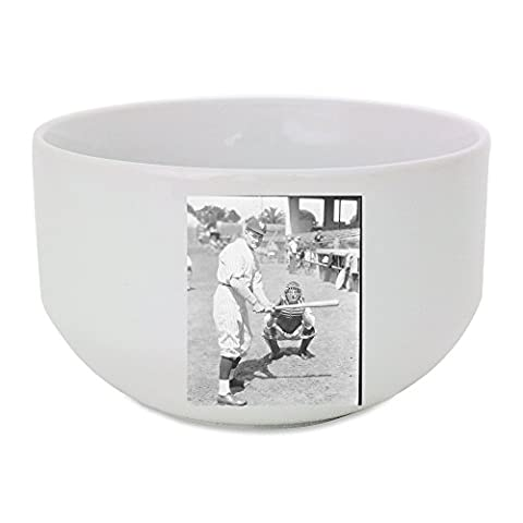Ceramic bowl with man is playing baseball match.