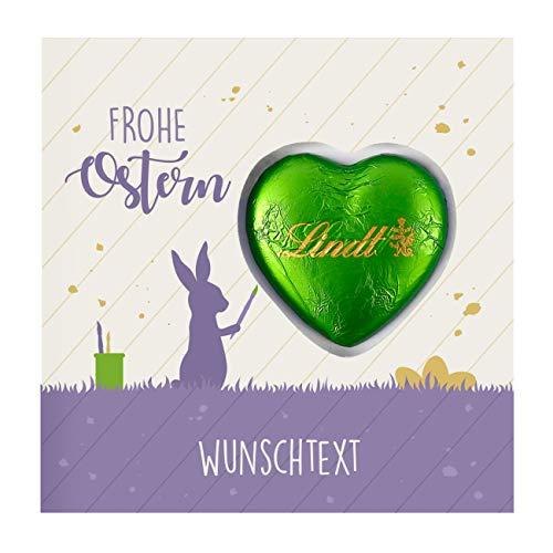 Herz & Heim® Süße Ostergrüße - Grußkarte inkl. Lindt Schokoladen-Herzen Osterhase mit Ihrem Wunschtext