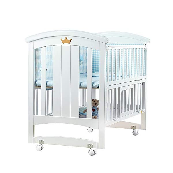 QINYUN Crib Baby Cradle Bed With Roller Solid Wood Multi-function Game Bed QINYUN 1. European classic bed type smooth curved corners: noble and elegant curved bed head polished many times without edges and corners to avoid baby scratches and scratches. 2. Crown decoration: cute crown three-dimensional decoration, I heard that both the prince and the princess like it. 3. Pacifier material anti-mite: the same material as the nipple, hardened, moderate hardness, care for the baby's young gums. 1