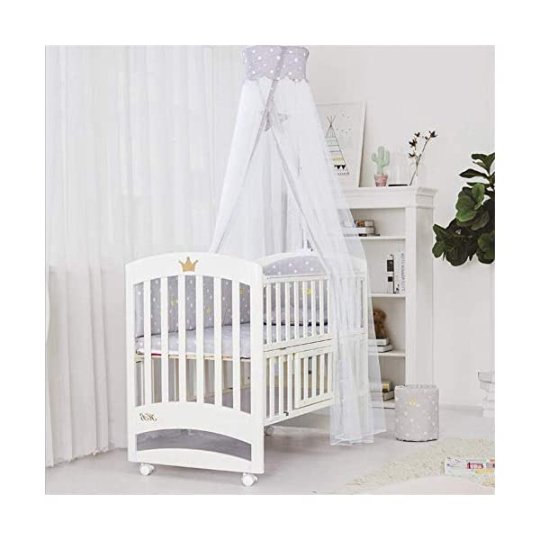 Solid Wooden Baby Cot,toddler Bed, Multifunctional White Cradle Bed Newborn Stitching, Height Adjustable HXYL Package contains bed, mosquito net, mosquito net pole, moving caster, kit Split panel for connecting to a large bed Three heights are adjustable to suit your child's different needs 2