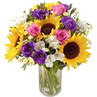 Fresh Sunshine Flowers with FREE Delivery - A wonderfully bright and cheery bouquet filled with Sunflowers, Lisianthus, Roses and Alstomerias hand tied in matching cellophane using real floristy skills and a big hand made bow