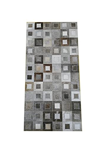Zerimar cowhide area rug patchwork style Size: 23x46 inches handmade