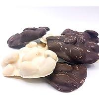 Le autentiche mandorle siciliane annegate in pregiato cioccolato fondente e bianco. Confezione regalo a cofanetto. RAREZZE: antico laboratorio di pasticceria artigianale siciliana